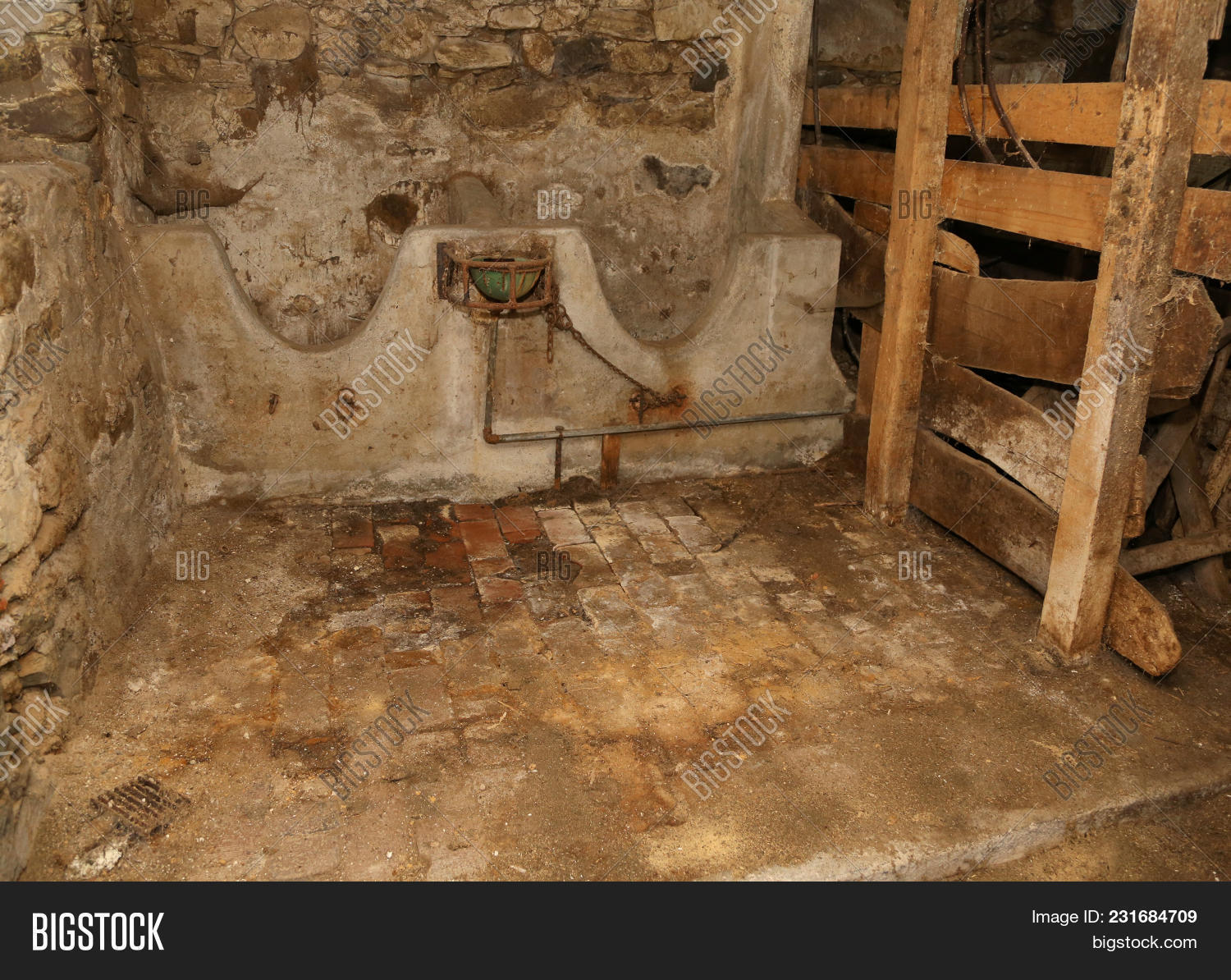 Interior Of An Old Barn With Abandoned Marble Manger