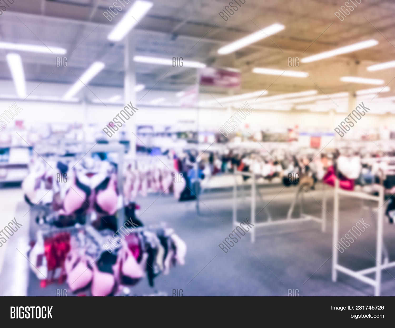 be0b2535890 Blurred abstract wide variety of bras intimate apparel at off-price  department store retailer. Colorful modern women lingerie