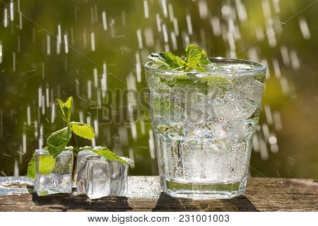 Two Glasses Of Soda Water On An Old Board, On Nature, Ice, Bubbles, Grapefruit, Spike, In The Backgr