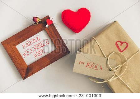 Happy Mother Day Text In Wooden Frame With Craft Gift Box On White Background