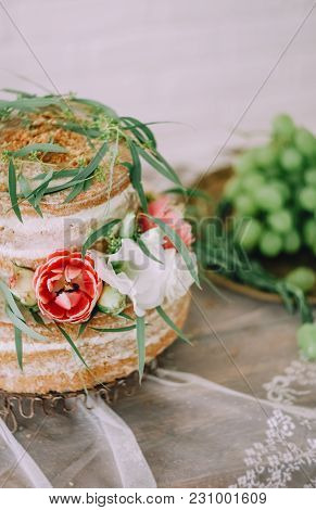 Rustic Wedding Cake On Wedding Banquet On The Table