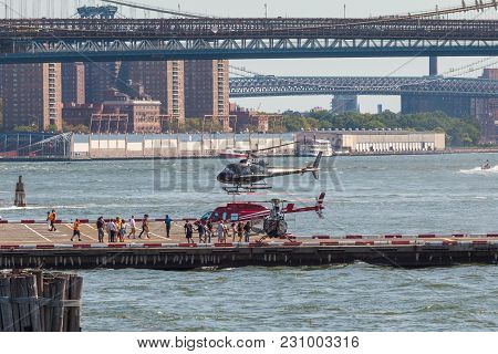 Black Helicopter Over Helipad In Lower Manhattan In New York.