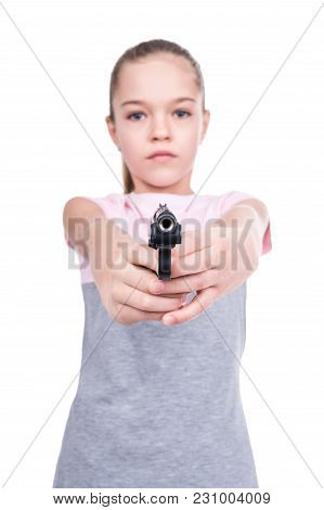 Young Girl Aiming A Gun At The Camera, Isolated On A White Background