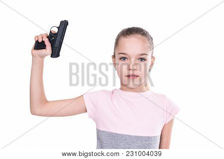 Young Girl Holding A Gun In Her Hand Pointing Upwards, Isolated On A White Background