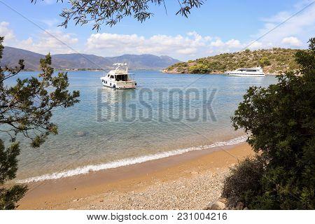 Summer Time Beautiful Yachts Anchoring In Love Bay Poros Island Greece. Horizontal.