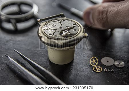The Process Of Installing A Part On A Mechanical Watch, Watch Repair