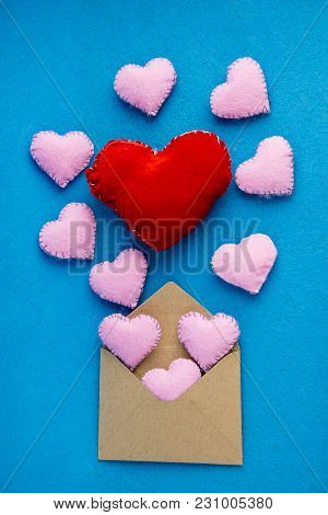 Romantic Letter: Craft Paper Envelope Open With Plush Hearts Flying Out. Concept Of Wedding Invitati