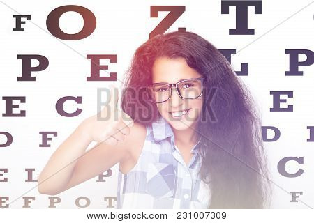 Beautiful Young Woman Wearing Glasses Close-up On White Background