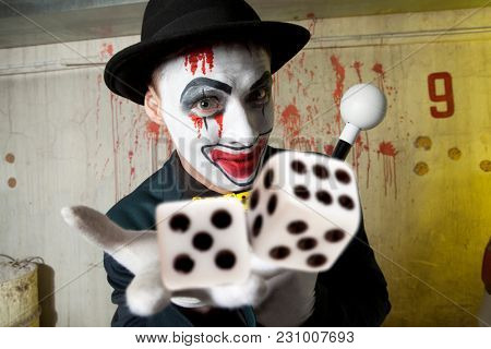 Bluff, Scary evil clown playing with dice