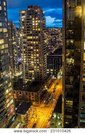 Modern North American Downtown Streets From A Tall Tower At Night When Nobody Is On The Street.