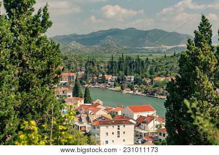 Inspirational Beautiful Landscape In Mediterranean Town With Sea, Coast And Valley. City In Green Va