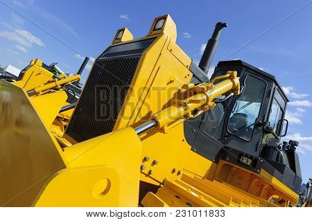 Bulldozer, Row Of Huge Yellow Powerful Construction Machines With Big Scoop And Tracks, Heavy Indust
