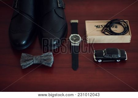 Close Up Of Groom Brown Leather Shoes, Bowtie, Belt And Wristwatch . Modern Man Or Groom Accessories