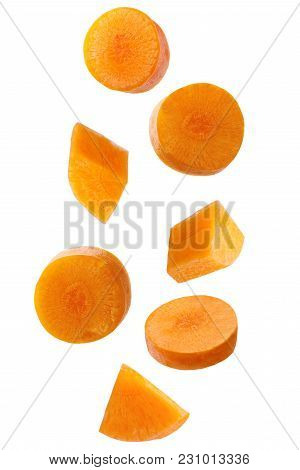 Isolated Falling Vegetables. Falling Piece Carrot Isolated On White Background With Clipping Path As