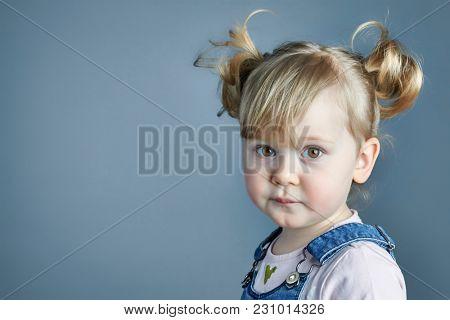 portrait of adorable female child studio shot