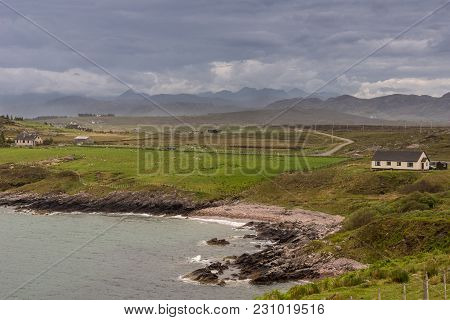 Invernasdale, Scotland - June 9, 2012: Heavy Dark Brown And Gray Cloudscape Over Landscape Along Loc