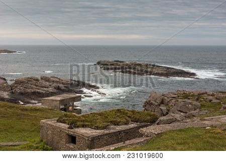 Inverasdale, Scotland - June 9, 2012: Ruins Of Brown Bunkers At Cove Light Anti Aircraft Battery Ww2