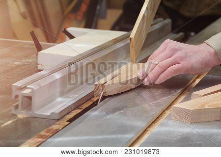 Carpenter Working On Woodworking Machines In Carpentry Shop. Male Hand Close Up