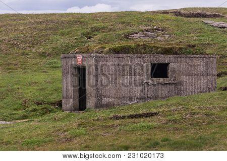 Inverasdale, Scotland - June 9, 2012: Closup Of Ruin Of Brown Bunker At Cove Light Anti Aircraft Bat