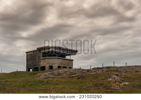 Inverasdale, Scotland - June 9, 2012: Ruins Of Brown Bunker At Cove Light Anti Aircraft Battery Ww2