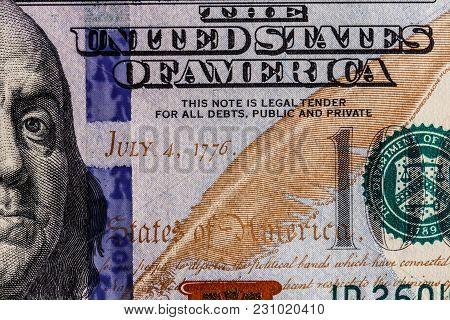 Closeup Of Ben Franklin And The Date Of Independence July 4, 1776 On A One Hundred Dollar Bill For B