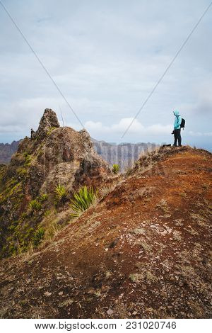 Traveler With Backpack Looking Over The Mountain Peaks. Stunning Arid Landscape Of Santo Antao Islan