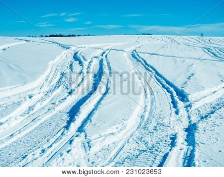 Traces of car tires on the snow