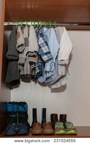 Bright Fashionable Children's Clothes In The Closet