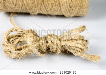 Jute Twine Rolled Up In Cradle. Accessories For Packing Postal Parcels On An Isolated Background.