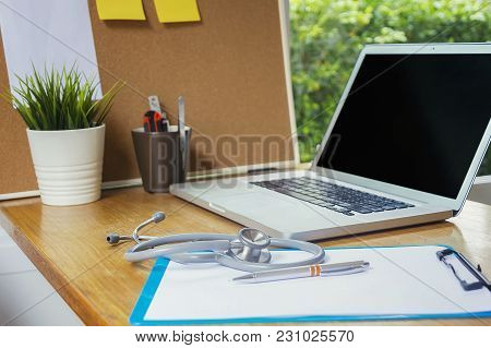 Stethoscope With Clipboard And Laptop On Desk,doctor Working In Hospital Writing A Prescription, Hea