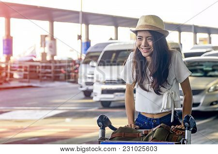 Young Woman In Airport Waiting For Air Travel.travel Concept.