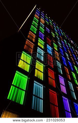 Colored Windows Texture.  Windows Illuminated By Neon Lights Background.