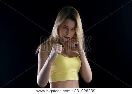 Beautiful Woman Boxer Portrait Over Dark Background.