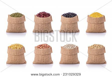 Collection Of Several Beans In Brown Small Sack. Studio Shot Isolated On White Background