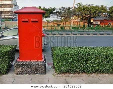 Clean Red Postbox On Footpath In Thailand