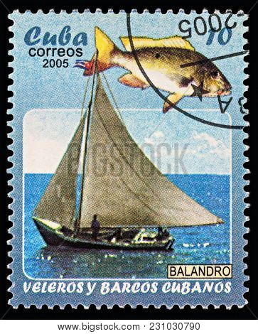 Moscow, Russia - March 12, 2018: A Stamp Printed In Cuba Shows Yacht And Fish, Series