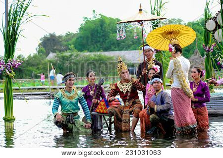 Ayutthaya, Thailand - May, 15, 2011: Men And Women Actors With Various Colors Of Dresses Performing