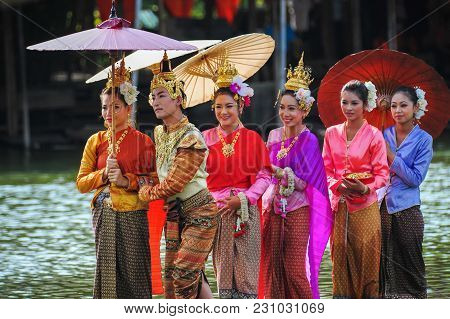 Ayutthaya, Thailand - May, 15, 2011: Man And Women Actors With Various Colors Of Dresses Performing