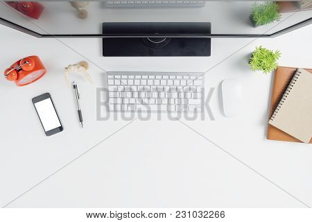 Modern White Office Desk Table With Computer,smart Phone,notebook And Cup Of Coffee.top View With Co