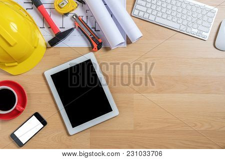 Office Desk With Laptop,smart Phone,tablet,cup Of Coffee And Engineer Equipment.top View With Copy S