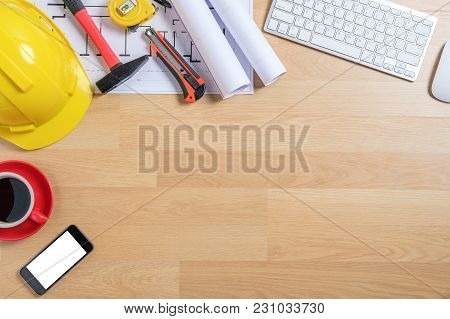 Office Desk With Smart Phone,computer, Cup Of Coffee And Engineer Equipment.top View With Copy Space