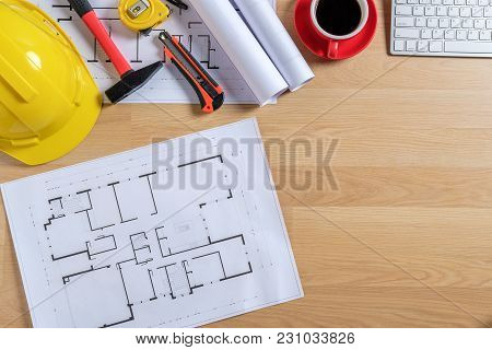 Office Desk With Computer, Cup Of Coffee And Engineer Equipment.top View With Copy Space. Background