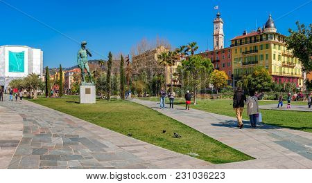 NICE, FRANCE - MARCH 26, 2016: People walking on Promenade du Paillon - 12 hectares and 1.2 kilometres urban park, inaugurated in 2013, popular place with locals and tourists.