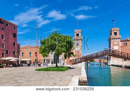VENICE, ITALY - APRIL 21, 2016: View of towers and bridge of  famous Venetian Arsenal - complex of former shipyards and armories, currently naval base and museum.