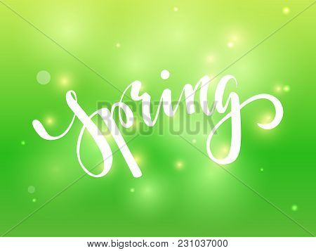 Spring. Hand Drawn Calligraphy And Brush Pen Lettering On Green Blured Background With Bokeh. Design