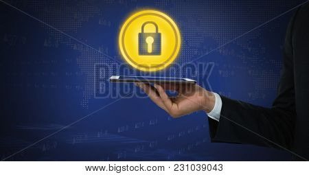 Digital composite of Bit coin icons and hand holding tablet and security lock icon