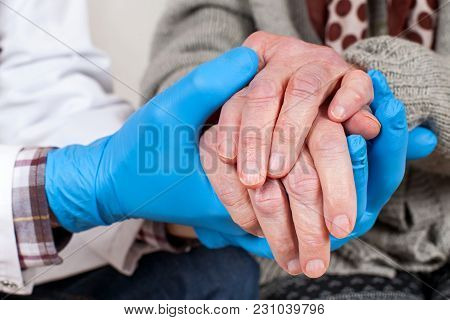 Doctor Holding Shaking Hands