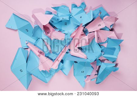 Details And Parts Of The Papercraft Scheme For Assembling Paper Or Cardboard Figures On A Pink Backg