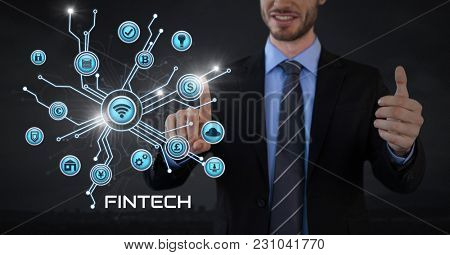 Digital composite of Businessman with hands palm open and with various business icons interface