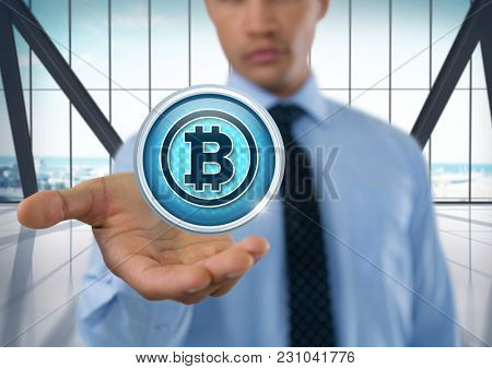 Digital composite of Bit coin icon and Businessman with hand palm open in city office